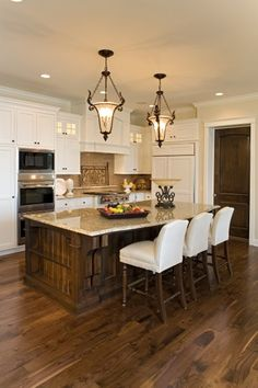 White Cabinets, dark floors and island