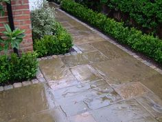 reclaimed paving slabs with granite sets edging