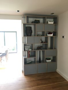 A recent find-  a polish company called Tylko. They pretty much make these shelves, but in many sizes and configurations. Service was amazing, and whilst flat pack, the quality of the shelves were exceptional.