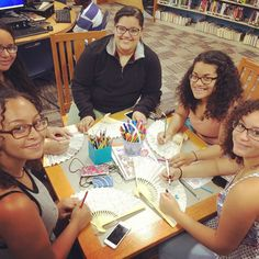 Some patrons in our teen room making use of art supplies. Sure looks like they are having fun! #otislibrary #artproject