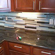 Gorgeous glass tiled backsplash