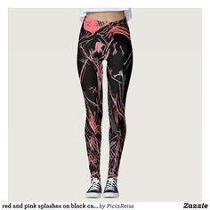 red and pink splashes on black canvas background leggings