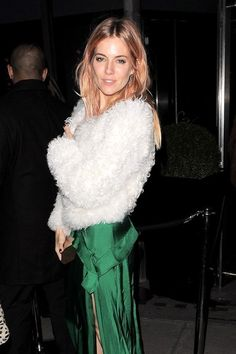 Sienna Miller Celebrities leave Playboy's 60th Anniversary Issue Party at the Playboy Club in London on December 3, 2013. The bash was co-ho...