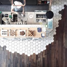 white hex tiles combined with wood flooring