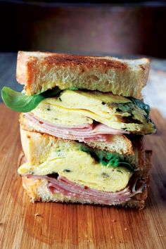 say breakfast / ham and egg breakfast sandwich with lemon curd and goat cheese)