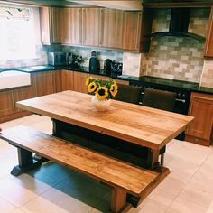 Our farmhouse-style Indiana Dining Table and Benches make the perfect addition to @bellepreferiti's beautiful kitchen, and those sunflowers add the perfect pop of colour.