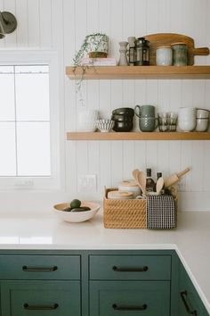 Feb 2020 - lovely farmhouse kitchen by Jaclyn Peters Design. The unusual grey green cabinets, vertical shiplap walls, the warm wood accents especially at the end of the island, the wide white oak floorboards and black accents. Modern Farmhouse Kitchens, Farmhouse Kitchen Decor, Cool Kitchens, Dream Kitchens, Tuscan Kitchens, Eclectic Kitchen, Luxury Kitchens, Farmhouse Sinks, Farmhouse Interior