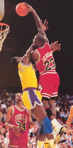 Michael Jordan dunking over Orlando Woolridge of the Los Angeles Lakers.