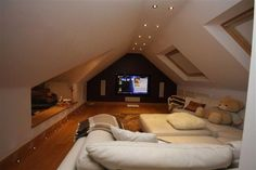 More ideas below: DIY Home theater Decorations Ideas Basement Home theater Rooms Red Home theater Seating Small Home theater Speakers Luxury Home theater Couch Design Cozy Home theater Projector Setup Modern Home theater Lighting System Home Theater Rooms, Home Theater Design, Home Theater Seating, Cinema Room, Attic Theater, Movie Theater, Attic Loft, Loft Room, Bedroom Loft