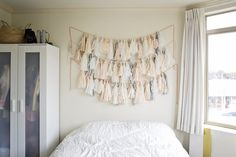 Myka and George's Modern Abode - tassels as headboard (works best with neutral bed linens I imagine)
