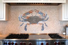 This custom kitchen features a handmade mosaic crab backsplash in Botticino, Blue Macauba, Celeste, Montevideo, Rosa Verona and Breccia Pernice from New Ravenna.<br /> <br /> For pricing samples and design help, click here: http://www.newravenna.com/showrooms/