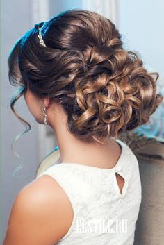 curly wedding updos and pearl headpieces