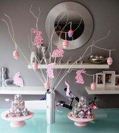 Easter Decorations - Tree decorated in pink easter eaggs and floral rabbits. Easter giveaways mini eggs in clear boxes.