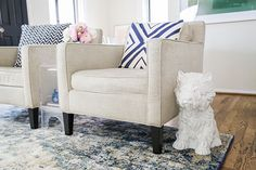 a beautiful blue loloi rug in a laurenconrad.com editor's living room