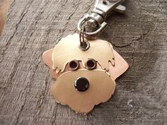 Soft Coated Wheaten Terrier Handcrafted Keychain/ID Tag by PoochTags $15 on Etsy. Made from mixed metals with rivets, studs, and seperate cut outs. Comes with a silver swivel clasp for attaching to pretty much anything.