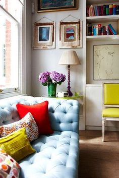 baby blue couch + bright pillows
