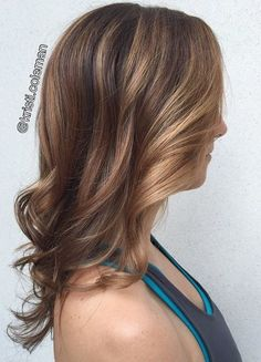 caramel highlights for fine hair and long, v-shaped layers to add bounce