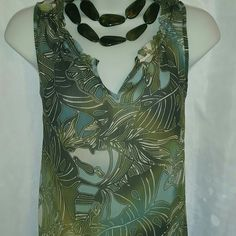 """Liz Claiborne Olive Floral Sleeveless Liz Claiborne chiffon tropical leaf printed top. Various shades of greens and blues print. Featuring gathered modified v-neck, sleeveless, relax fit top. Photo 4 is best for actual color  36"""" bust 24"""" overall length  100% poly Machine washable  Perfect condition Liz Claiborne Tops"""