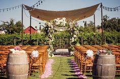 The ceremony setup included a gorgeous floral chuppah with a vineyard backdrop. Event design by Little Blue Box Weddings and floral design by Centerpiece Napa Valley.