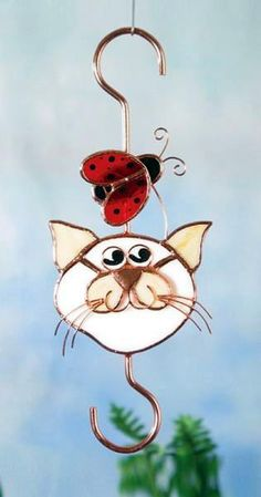 Garden Hook Cat and Ladybug Stained Glass.   Cat & Ladybug Small Hook.   Colors never fade even in the hottest sun.   Weatherproof and Waterproof  Copper Coated Steel for strength and years of use.    10 in x 6 in - holds up to 50 lbs.   Holds Flower baskets, Bird feeders, windchimes.