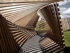 EKKO by Thilo Frank. Visitors to this installation in northern Denmark by German artist Thilo Frank are invited to walk through a contorted loop of timber while listening to the sounds of their voices and footsteps played back to them