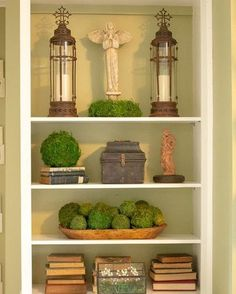Moss balls in several different sizes add so much visual interest to this shelf display.  Imagine this in your living room or dining space.  #moss #mossballs #shelfdecorideas #livingroominspo #driedmoss #homedecorideas #homedecorinspo #livingroomdecor #diningroom #diningroomdecor #modernfarmhouse #moderndecor #moderndesign #farmhousedecor
