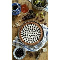 Sorghum tart with chocolate ricotta cheese rum and grapes