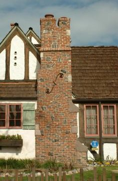Pyke House, a Tudor/Storybook cottage :: pic 3 of 4 :: The chimney collapsed in a recent earthquake. The owner used photos of the house to have it rebuilt, putting each of the crazed-and-clinker bricks back in its original position.