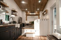"""The """"Noyer"""" by is a Tiny House on wheels built on a trailer which makes the space feel so open! Tiny House Movement // Tiny Living // Tiny House Living Room // Tiny Home Kitchen // Tiny Houses For Sale, Tiny House On Wheels, Tiny Living, Living Spaces, Living Room, Rv Living, Minimaliste Tiny House, Cedar Cladding, Tiny House Listings"""