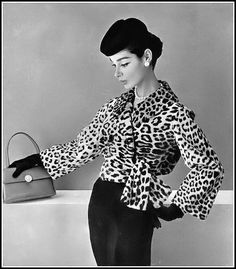Jacky Mazel in short leopard jacket wrapped and tied to the side by Lanvin-Castillo, handbag by Ferest, hat by Legroux, photo by Pottier, 1956