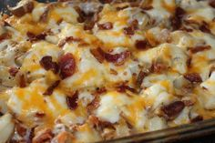 Ingredients:  7 medium red potatoes – baked  1/4 tsp salt and pepper  1 lb bacon, cooked and crumbled  3 c sour cream  2 c mozzarella cheese, shredded  2 c cheddar cheese, shredded  3 green onion, sliced              Directions:  Cut baked potatoes into 1 inch cubes.