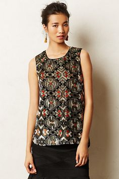 This simmer tank from Anthropologie is perfect for holiday wear and looks great with jeans!