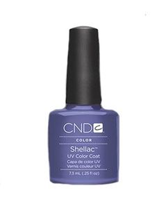 It's purple with a hint of grey.   CND SHELLAC NAIL POLISH IN PURPLE PURPLE, $20. CND.COM.