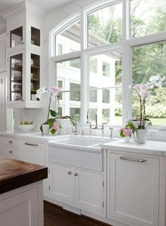 Great looking white kitchen with lots of windows for a great view