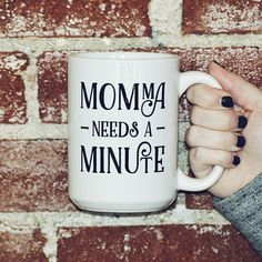 """Momma Needs a Minute - 15oz Coffee Mug. Seriously, momma needs a minute. This mug could be used everyday and would be totally applicable. Available in 15 oz. or 11 oz. Ceramic Coffee Mug (Please see separate listing for 11oz option) Product Material: Ceramic Microwave and Dishwasher Safe Mug Color: White Text color: Black Text reads: """"Momma Needs A Minute"""" Right or left handed - doesn't matter! This is a double-sided print. Same design on both sides. See images for more details. FRANK..."""