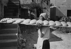 Woman carrying plank with 11 loafs of bread on her shoulder. Probably Greece, Crete Greece, Athens Greece, Old Photographs, Old Photos, Greece Pictures, Crete Island, Essay Writer, The Old Days, Insta Posts
