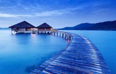 So just how does the 1% go on holiday? In an overwater villa, perched on stilts above some of the clearest waters on earth.