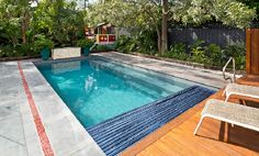 Leisure Pools have taken this stylish rectangular swimming pool to the next level by adding a built-in housing for an automated pool cover. Swimming Pool Landscaping, Swimming Pool Designs, Outdoor Swimming Pool, Diy In Ground Pool, Pool Safety Covers, Leisure Pools, Pool Shapes, Fiberglass Swimming Pools, Rectangular Pool