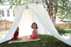 Backyard tent (or reading nook, or fort, or...): 1 hula hoop, 4 shower curtain liners, 40 pull ties, and a bit of rope.