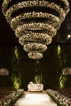Flower hedges lining the aisle and a flower chandelier