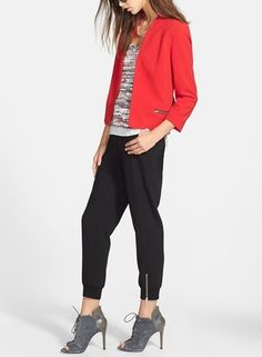Trending for fall. Cute track pants with a fitted blazer and stunning booties.