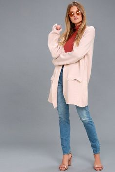 Lulu's pink sweater coat with red top and medium wash jeans