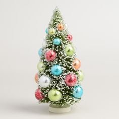 Heavily glittered for a just-brought-in-from-the-snow look, our bottlebrush tree is bejeweled with candy-colored baubles for dazzling vintage appeal.