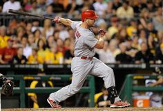 Matt Holliday hits a two run single during the seventh inning against the Pittsburgh Pirates. Cards won 3-2.  8-25-14
