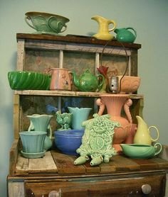 Love all the different colors in the vintage pottery display