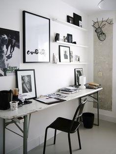 Home office com quadros atenção a decoração