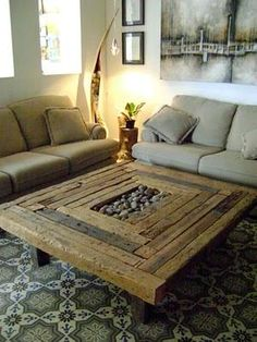 This coffee table  is manufactured by recycling wood strips which have since finished rustic and natural, even with the inclusion of pebble stones in the middle.