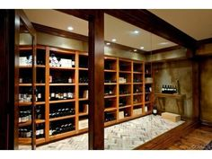 This glass enclosed in-house wine cellar is the go to spot for entertaining in this Irvine, CA home. Listed at $7,950,000.