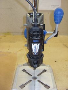 She uses a dremel drill stand and a sewing machine foot with her dremel to drill beach glass, stones and pebbles
