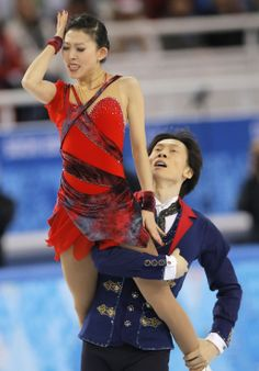 Pang Qing and Tong Jian of China compete in the pairs free skate figure skating competition at the Iceberg Skating Palace during the 2014 Wi...